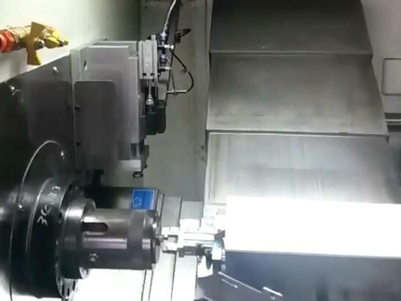 CNC lathe machine SNK-46 processing a cell phone parts